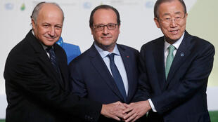 French President François Hollande (centre) and foreign minister Laurent Fabius (left) with UN Secretary General Ban Ki-moon at the COP21 summit on Monday.