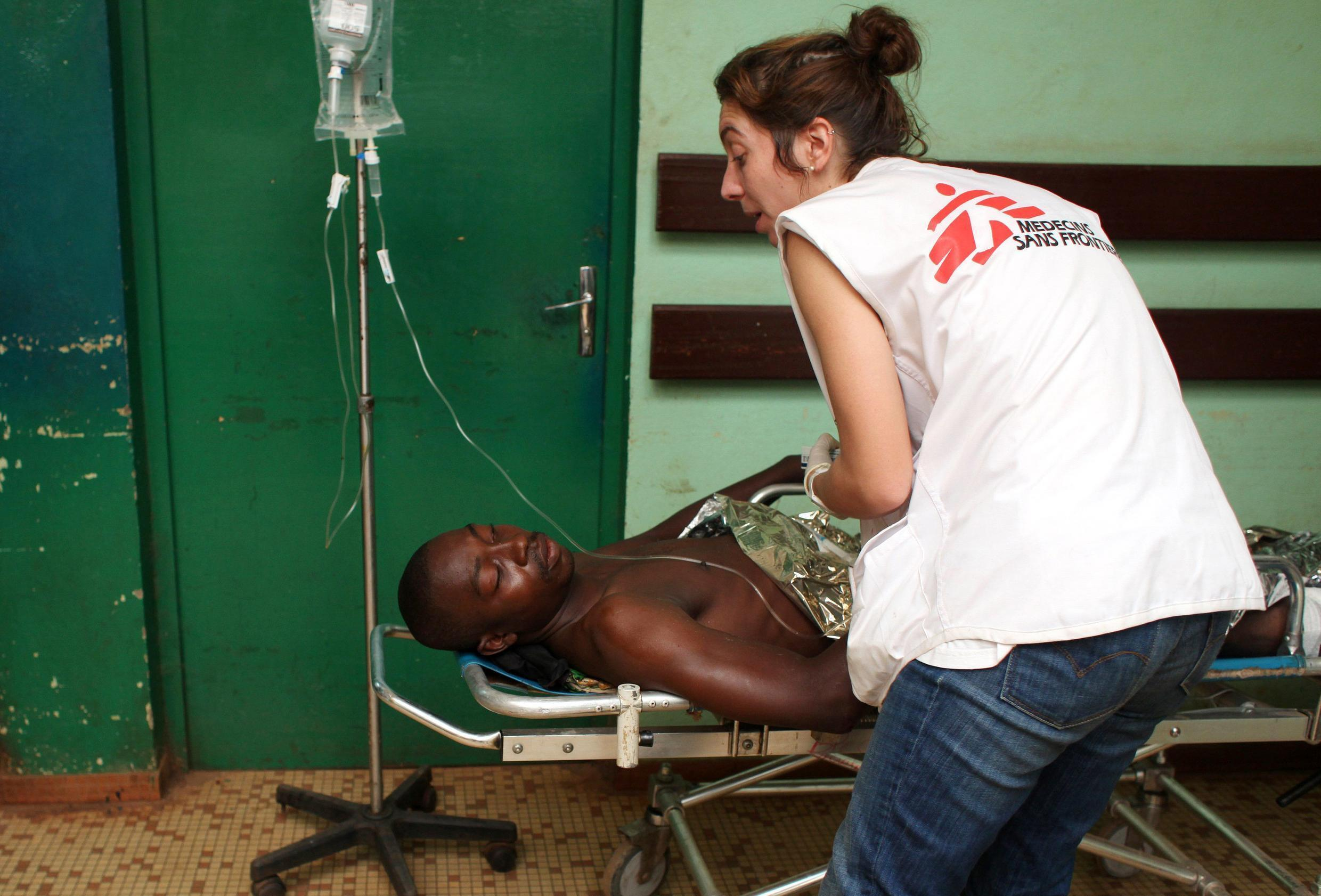 A Doctors Without Borders volunteer tends to a wounded man in Bangui