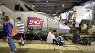 Delayed passengers wait in Montparnasse train station in Paris on July 27, 2018.