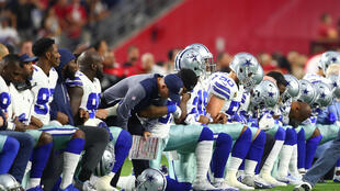 Sep 25, 2017; Glendale, AZ, USA; Dallas Cowboys players kneel together with their arms locked prior to the game against the Arizona Cardinals at University of Phoenix Stadium