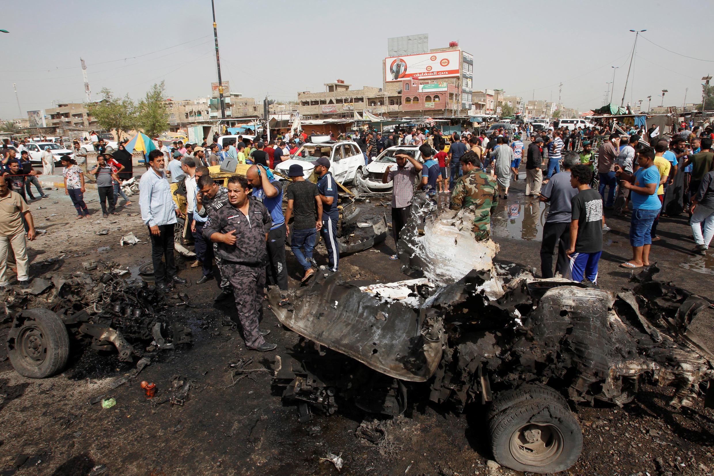 На месте взрыва в районе Садр-Сити в Багдаде. 17 мая 2016