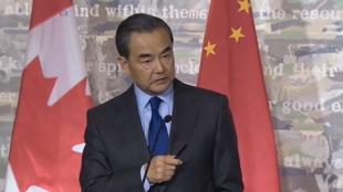 中國外長王毅六月一日在加拿大渥太華新聞會上怒斥記者就人權問題發問