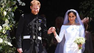 Prince Harry, Duque de Sussex e Meghan, Duquesa de Sussex, na saída da Igreja São Jorge no Castelo de Windsor, após a cerimônia de casamento.