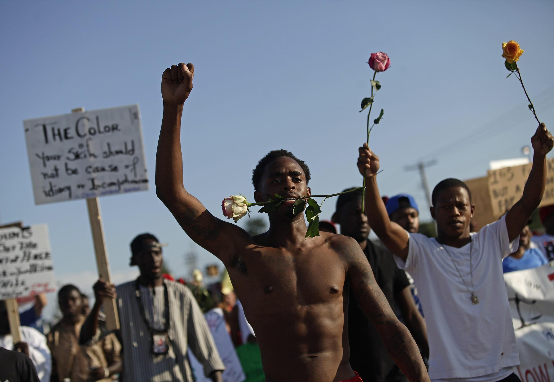 Demonstrators in Ferguson, 19 August 2014