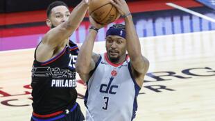 Philadelphia 76ers Ben Simmons, left, blocks Bradley Beal of the Washington Wizards