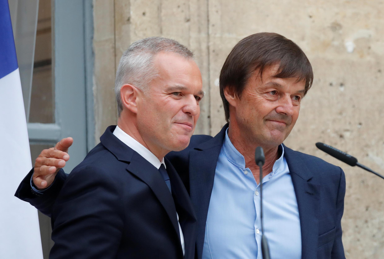 Бывший и нынешний министры экологии Николя Юло (справа) и Франсуа де Рюжи