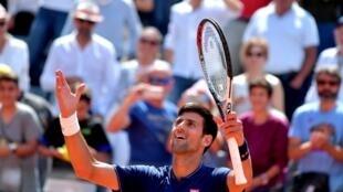 Novak Djokovic celebrates after winning his Rome Masters quarter-final match against Juan Martin Del Potro on May 20, 2017.