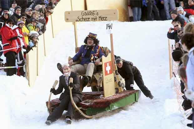 Contestants in the Hornshlittenrennen sleigh race dress up as Kadhafi and Swiss Finance Minister Hans-Rudolf Merz