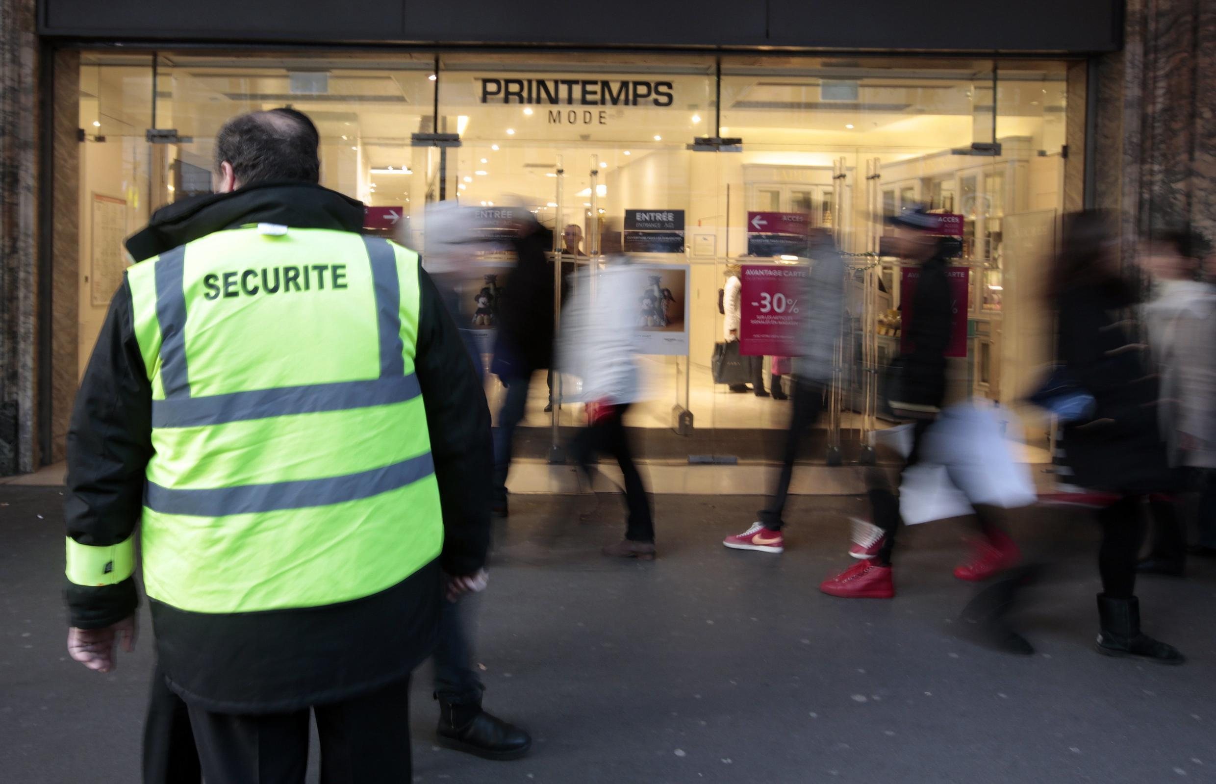 A security guard patrols near the Printemps department store in a shopping district in Paris, France, November 23, 2015 a week after a series of deadly attacks in the French capital