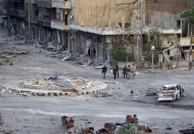 Explosão de carro-bomba em Deir al-Zor, 15 de abril de 2013.