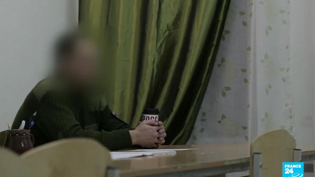 Một thủ lĩnh bán quân sự chuyên tuyển mộ người Nga đi đánh thuê tại Syria, chấp nhận trả lời phỏng vấn đài France 24 ngày 23/02/2018. Ảnh chụp màn hình.