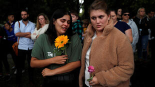People react near Masjid Al Noor mosque in Christchurch, New Zealand, March 17, 2019.