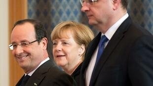 Le président français François Hollande et la chancelière allemande Angela Merkel au sommet de Varsovie, le 6 mars 2013.