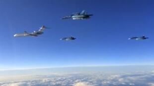 3月15日,在敘利亞Hmeymin基地起飛返國的俄軍戰機。