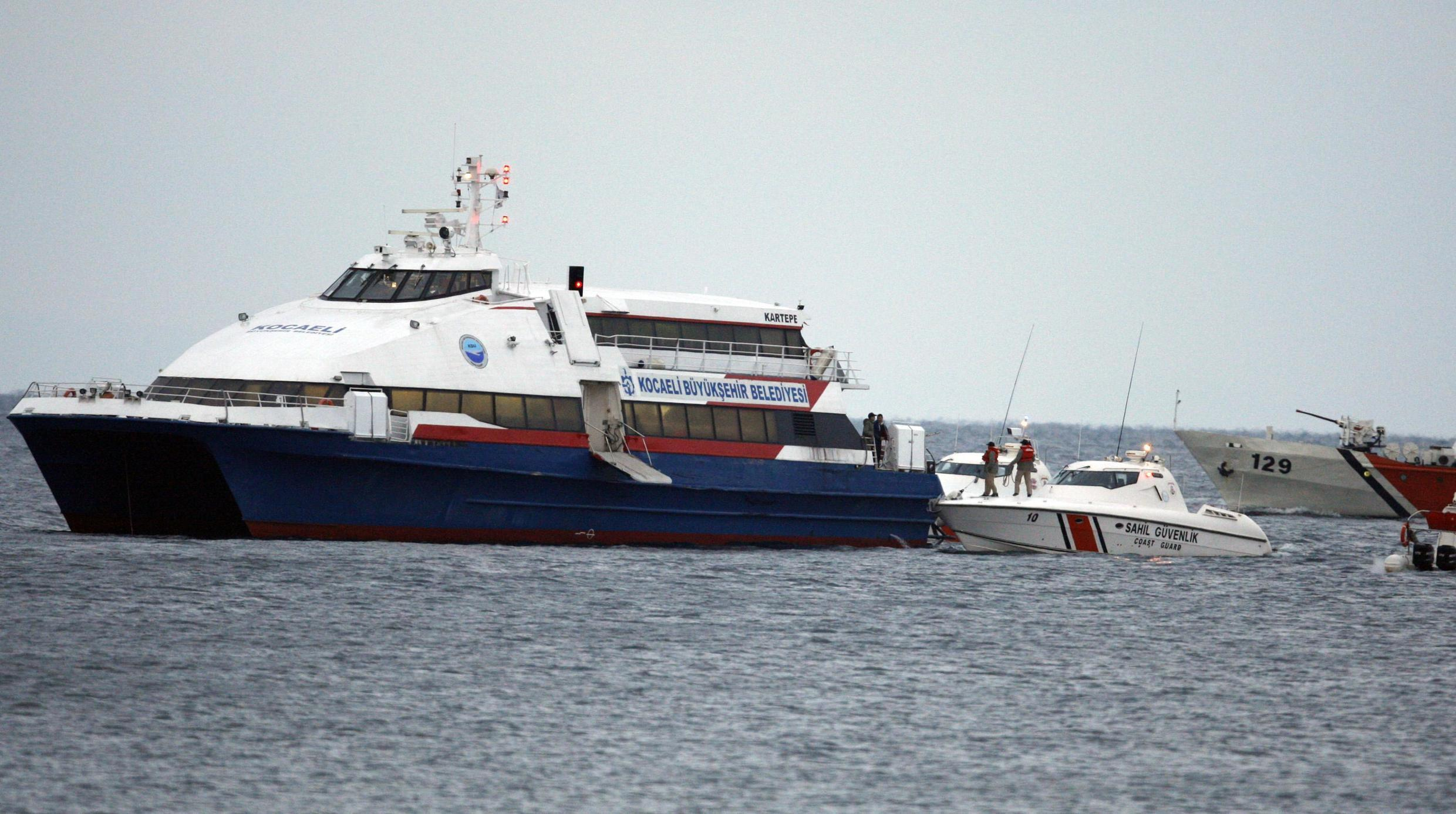 Coastguards prepare to board the Kartepe ferry to disembark the hostages
