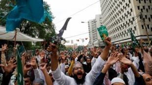 La republication des caricatures de Mahomet par «Charlie Hebdo» a déclenché des manifestations dans certains pays, comme ici à Karachi, au Pakistan, le 4 septembre 2020.