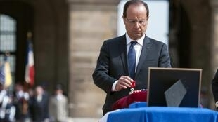 Francois Hollande during a military ceremony in honour of the dead soldiers