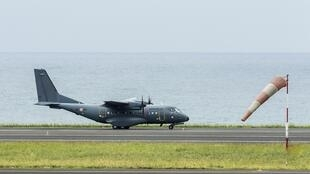 A French military transport plane taxis on the runway at the airport in Saint-Denis at the start of a search mission along the coast near Saint-Andre on the French Indian Ocean Reunion island August 7, 2015.