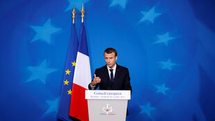 French President Emmanuel Macron addresses a news conference during the EU leaders summit in Brussels