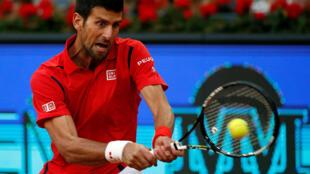 Novak Djokovic in action against Kei Nishikori at Madrid Masters.