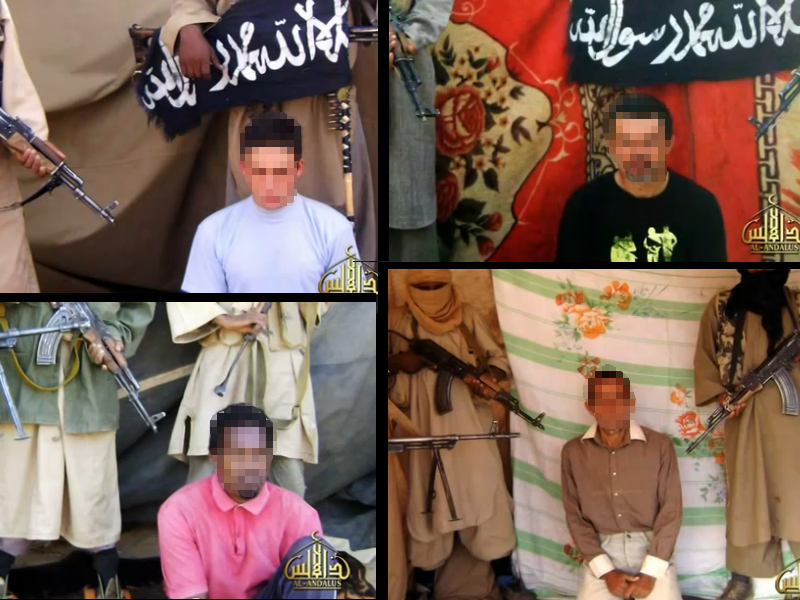 Four French hostages held by Aqim from a video distributed in April