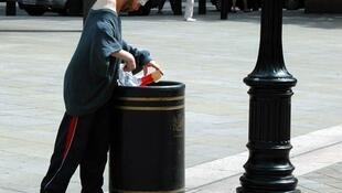 A man finding food in a bin in London