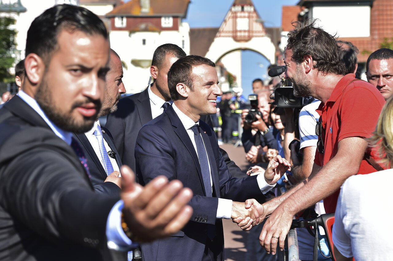 Former presidential aide Alexandre Benalla (left), accused of abuse of power and violence against protesters, caused a big upset in Macron's government. (Both pictured here at Le Touquet, France, June 2017)