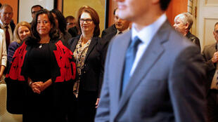 FILE PHOTO: Newly appointed Canadian Veterans Affairs Minister Jody Wilson-Raybould and president of the Treasury Board Jane Philpott watch Prime Minister Justin Trudeau arrive as he shuffles his cabinet, Ottawa, Ontario, Canada, January 14, 2019