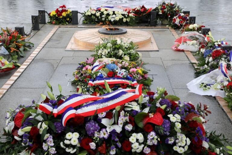 Floral tributes lie beside the tomb of The Unknown Soldier at the Arc de Triomphe in Paris on 11 November 2018.