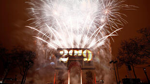 Fireworks explode during the New Year's celebrations at the Arc de Triomphe in Paris, France,