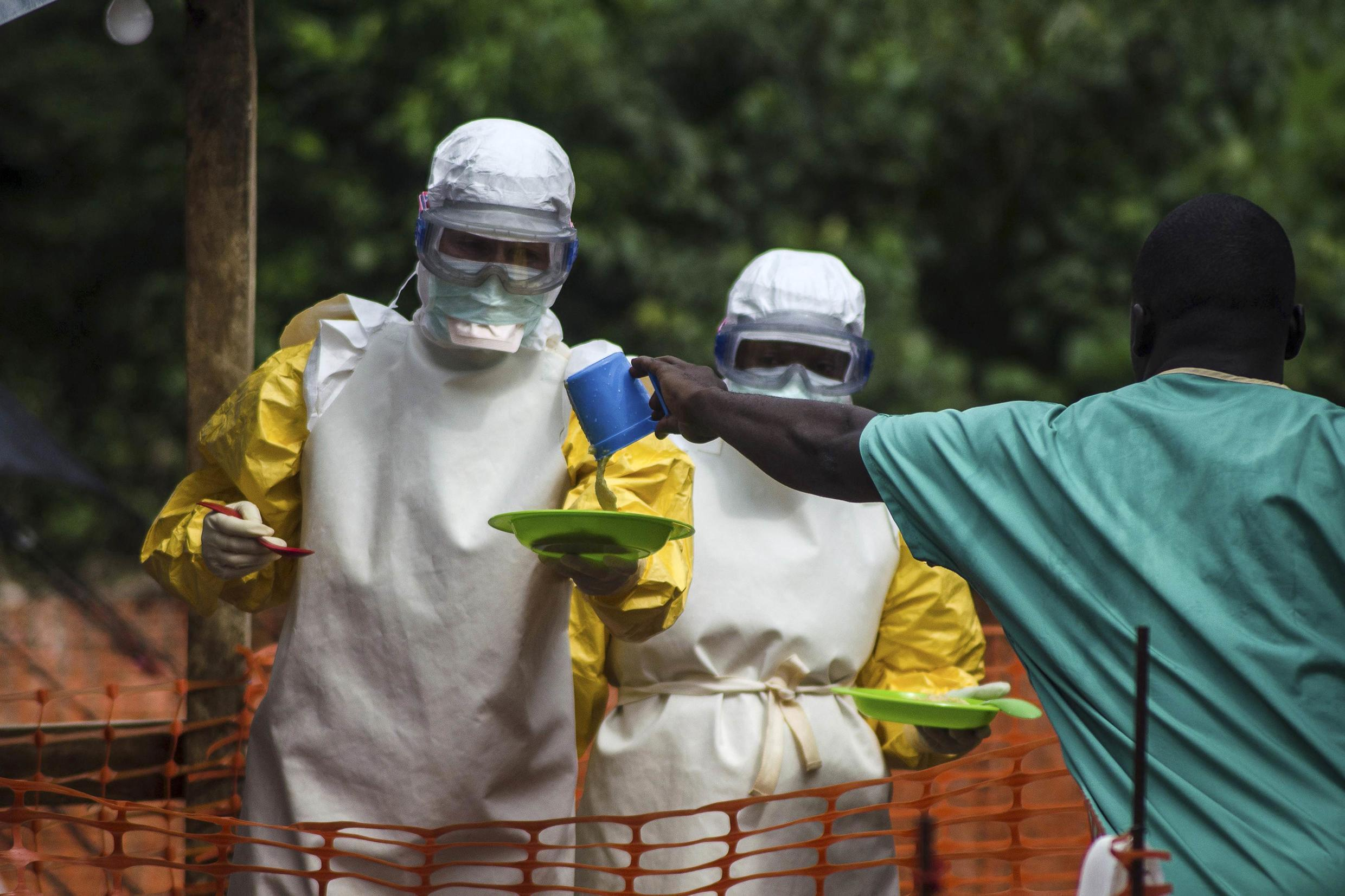 Staff preparing food for patients at Doctors Without Borders' Ebola treatment centre in Kailahun, Sierra Leone. 20 July 2014.