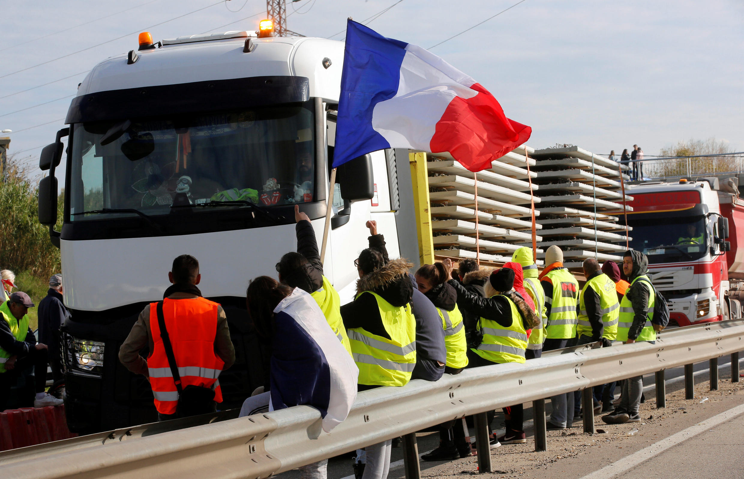 Demonstrators wearing yellow vests, a symbol of a French drivers' protest against higher fuel prices, block access to the fuel depot in Fos-sur-Mer, France, November 19, 2018.