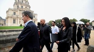 Members of the Charrihi family, victims of the terror attack at the Promenade des Anglais in Nice on July 14, 2016, arrive at the Hotel des Invalides to attend the France's national tribute to victims of terrorism on September 19, 2016 in Paris.