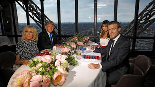 Brigitte Macron (L), wife of French President Emmanuel Macron (R), U.S. President Donald Trump (2ndL) and First lady Melania Trump at  Eiffel Tower's Jules Verne restaurant last year