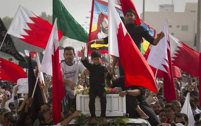 The son of Redha Mohammed gestures during his father's funeral in Malkiya, west Manama