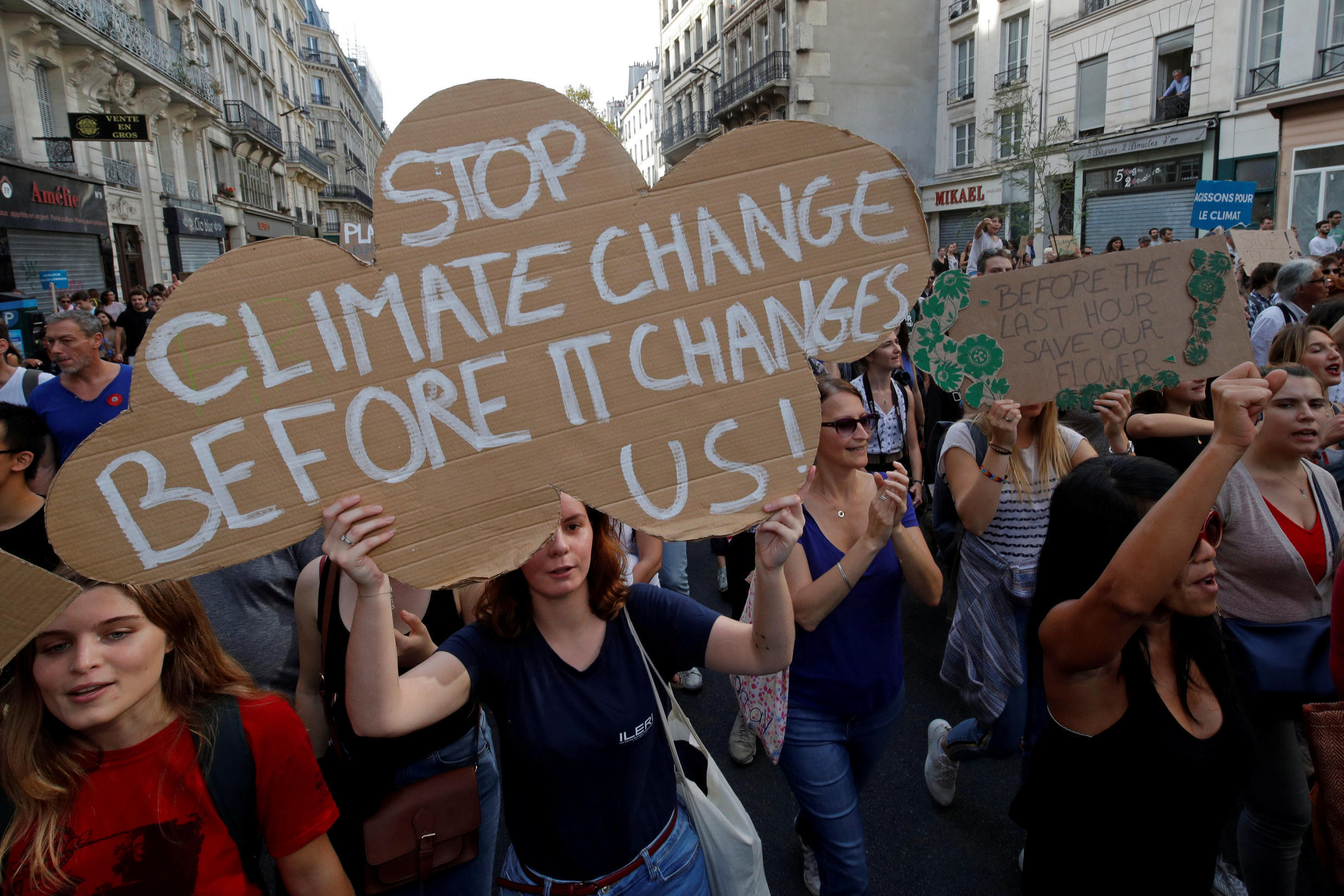Youth activists take part in a climate march in Paris, 13 October 2018