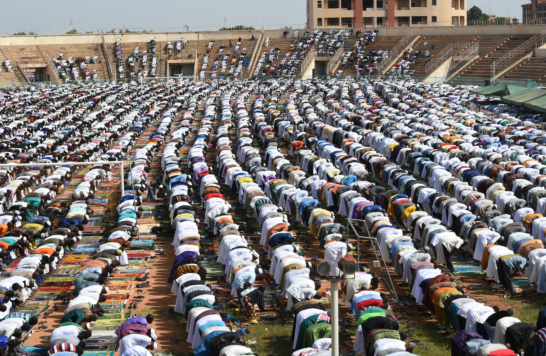 Muslim faithfuls pray to celebrate Eid at Ouagadougou's stadium.