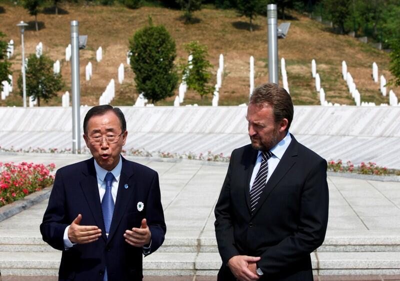 U.N. Secretary General Ban Ki-moon (L) and Chairman of the Tripartite Bosnian Presidency Bakir Izetbegovic speak to the media at the Memorial Center in Potocari, near Srebrenica, 26 July, 2012.