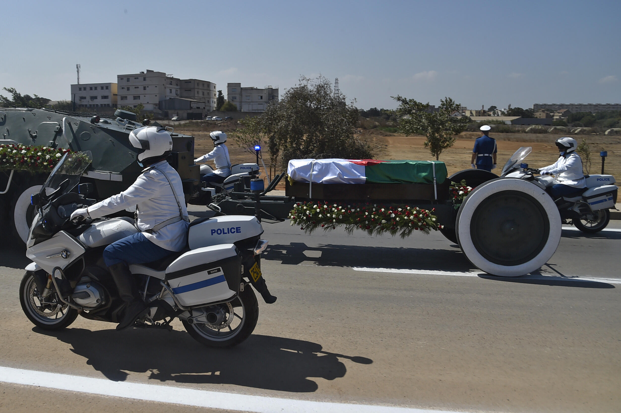 Algerian security forces escort the coffin of former president Abdelaziz Bouteflika to El-Alia cemetery in the capital Algiers on September 19, 2021