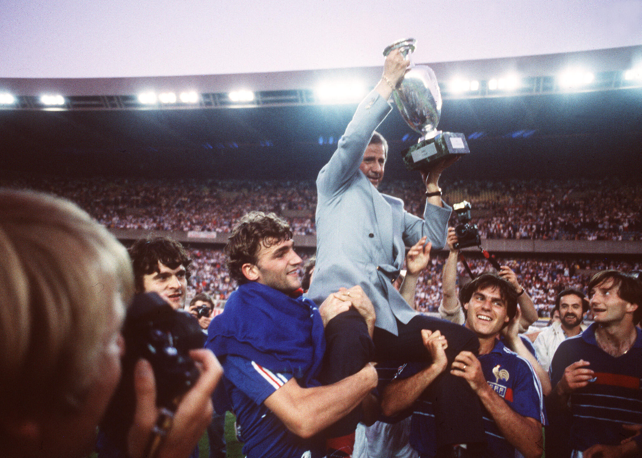 Coach Michel Hidalgo, carried in triumph by his players after the coronation of the Blues at Euro-1984, on June 27 at the Parc des Princes