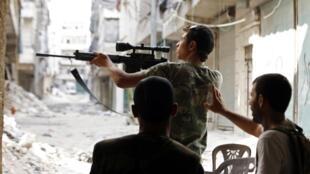 Wasu daga cikin  'Yan tawayen kasar Syria masu yaki da Gwamnatin Shugaban kasa Bashar Assad