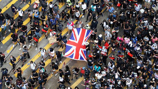 Some protestors in Hong Kong have called on London to protect its former colonial subjects.