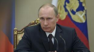 Vladimir Poutine au Kremlin, le 21 mars 2014.