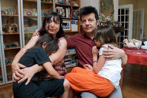 Sylvie and Dominique Mennesson with twins Valentina and Fiorella in 2000
