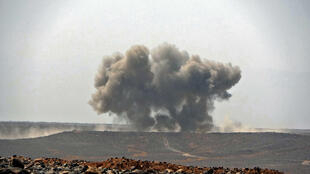 Smoke billows during clashes between forces loyal to Yemen's Saudi-backed government and Huthi rebel fighters in the northeastern province of Marib on March 5