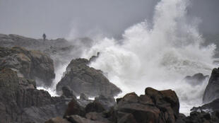 Waves hit the coast at Batz-sur-Mer, western France, a day before storm Carmen's arrival