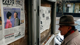 A man reads morning papers in Chisinau on October 31, after the first round of Moldova presidential election.