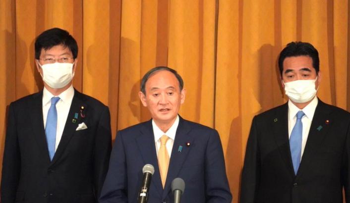 四方安全对话领导人峰会结束后,日本首相菅义伟参加记者会