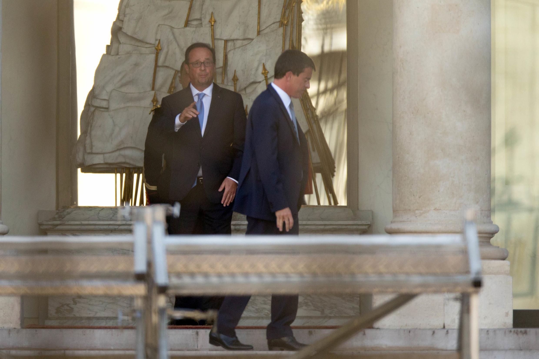 O presidente François Hollande e o primeiro-ministro Manuel Valls, no palácio do Eliseu
