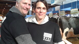 Dairy farmers Friso and Andrea Djis at the agriculture fair, wearing shirts protesting low prices paid to farmers